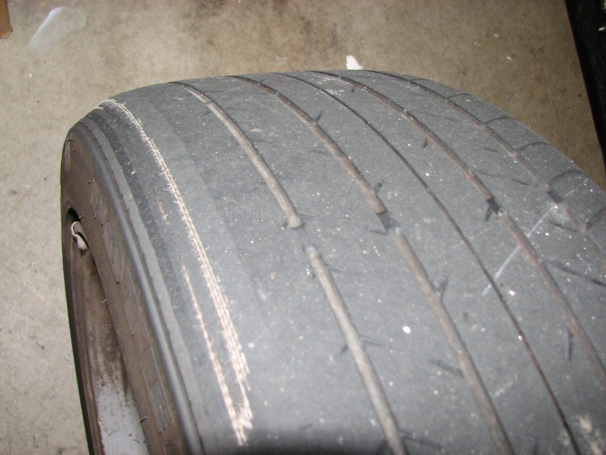 Inner tire wear showing cords